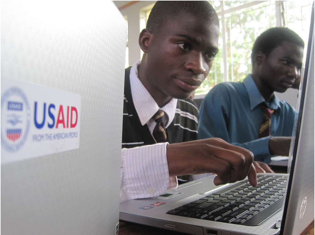 USAID student with laptop