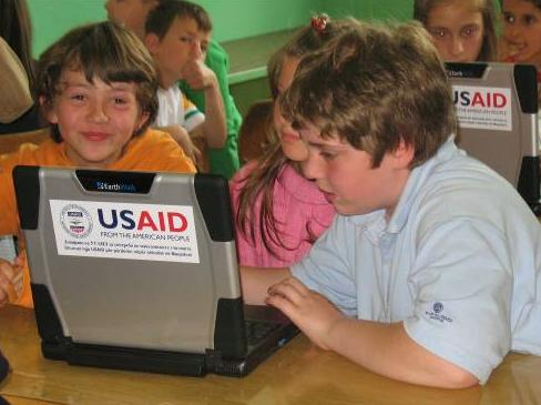 Group of USAID students with laptops