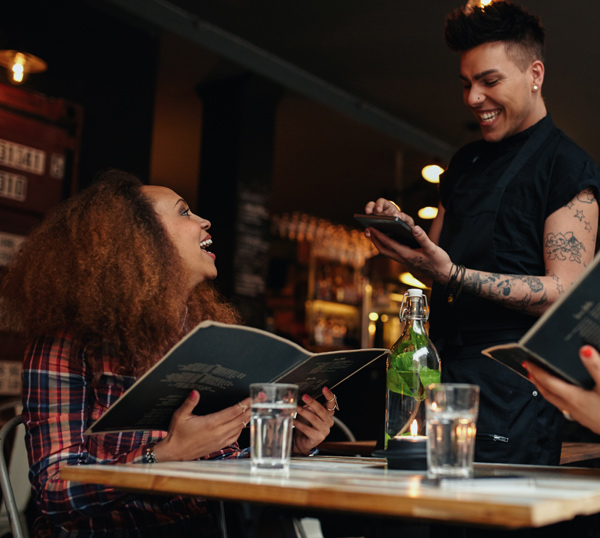 server takes order with tablet