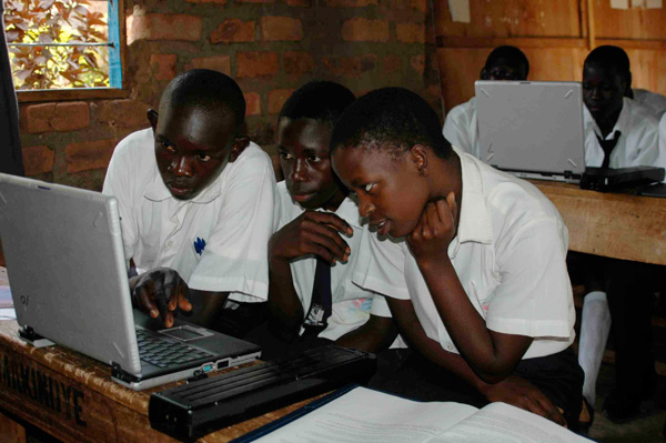 Uganda students using laptops