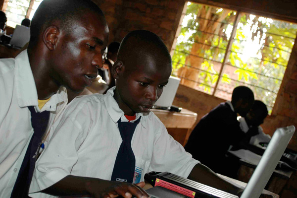 Students learning with laptops