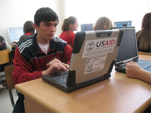 Students using laptops provided by EarthWalk