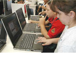 Puerto Rico students using laptopvia 1-to-1 deployment