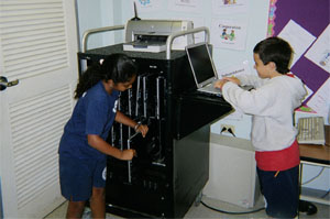 Students access laptops via EarthWalk Flexcart
