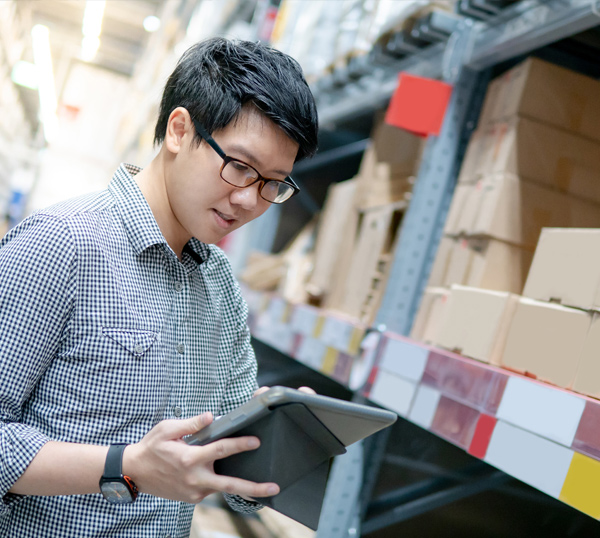 warehouse worker using tablet device